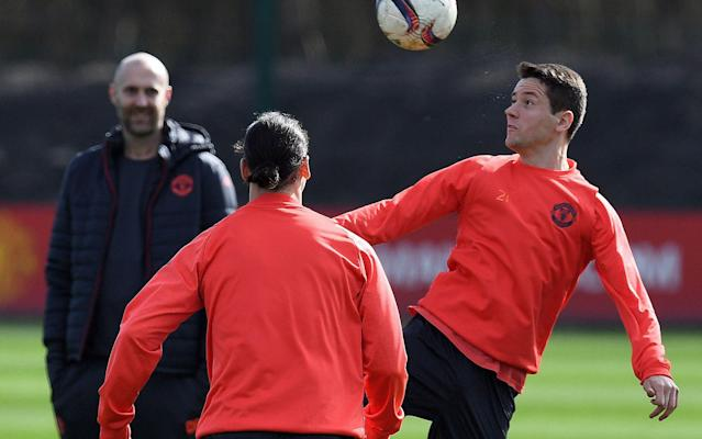 <span>Herrera here pictured presumably losing a game of head tennis with teammate Ibrahimovic</span> <span>Credit: PAUL ELLIS/AFP/Getty </span>
