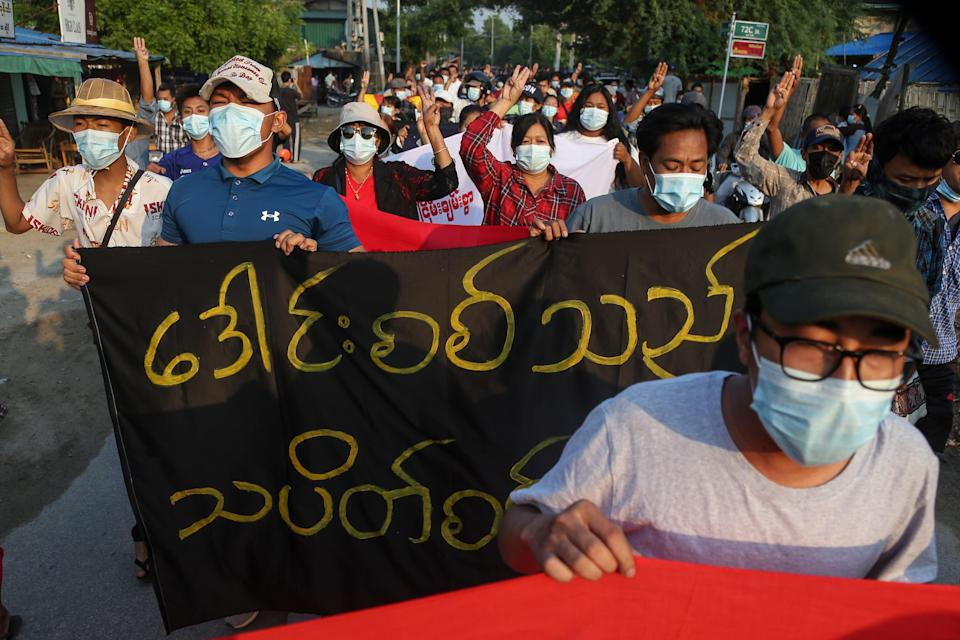 <p>Demonstrators march during an anti-military coup protest in Mandalay</p> (EPA)