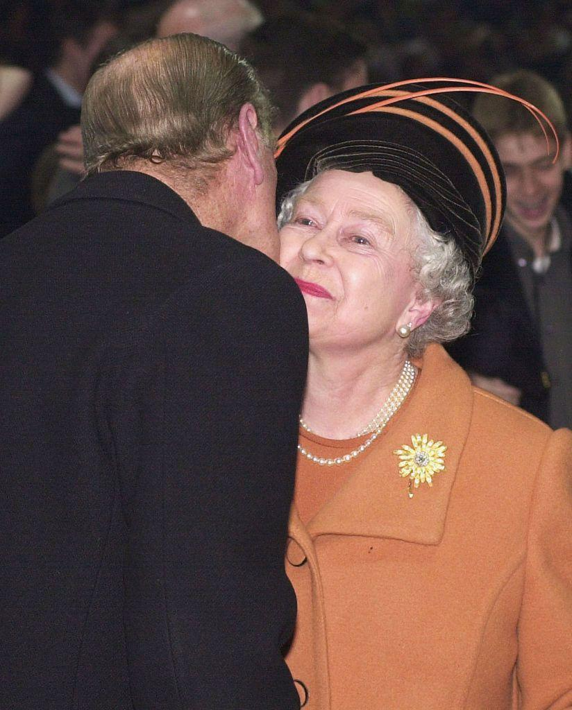 <p>The Duke of Edinburgh kisses the Queen on the cheek at the Millennium Dome in London on New Year's Eve, 1999.</p>