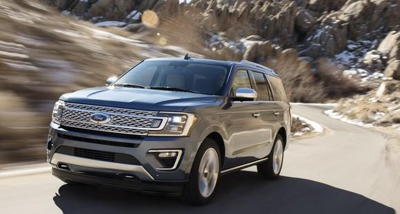 A 2018 Ford Expedition, a big SUV, on a mountain road.