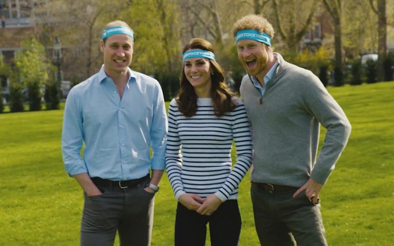 Prince Harry and the Duke and Duchess of Cambridge wear headbands for Heads Together, which is the main charity for the Virgin London Marathon this year - Credit: PA