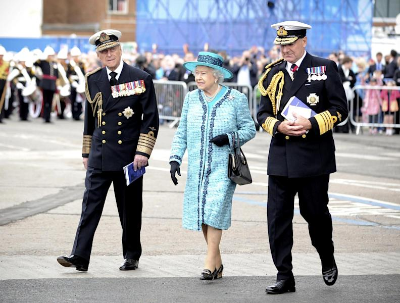 A Ministry of Defence handout picture shows Queen Elizabeth II and Prince Philip, The Duke of Edinburgh (L) arriving for a ship-naming ceremony conducted at Rosyth Dockyard in Rosyth, Scotland on July 4, 2014 (AFP Photo/Thomas Tam McDonald)