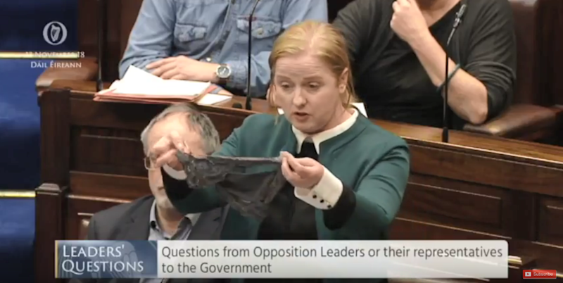 Ruth Coppinger holds up lacy underwear in parliament after rape acquittal.