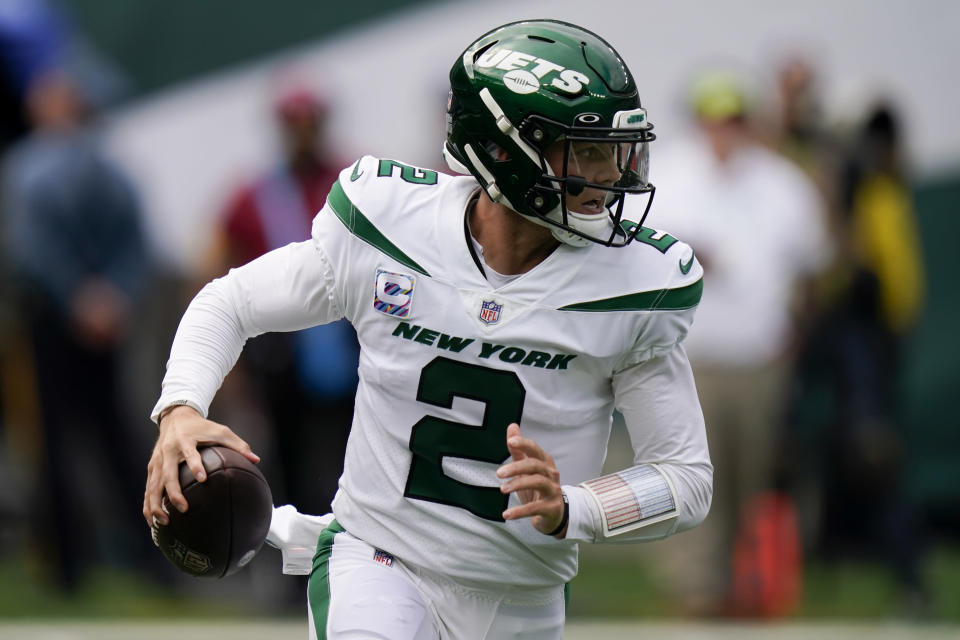 New York Jets quarterback Zach Wilson looks to pass on th run during the first half of an NFL football game against the Tennessee Titans, Sunday, Oct. 3, 2021, in East Rutherford. (AP Photo/Seth Wenig)