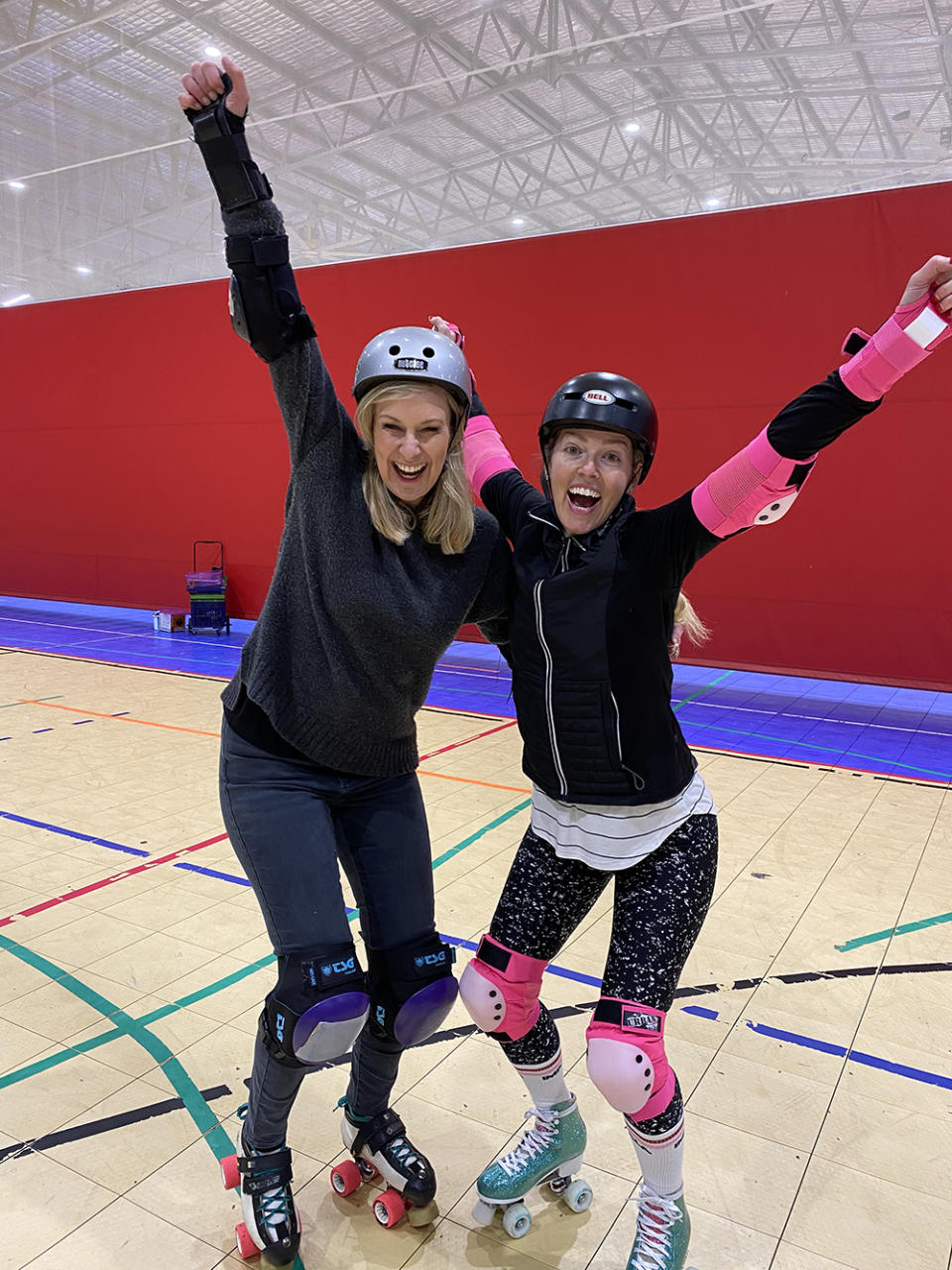 Melissa Doyle and Naima Brown wear roller skates and protective gear while recording episode six of the podcast Age Against The Machine
