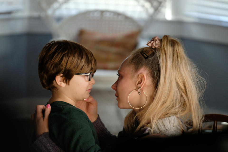 "This image released by Apple shows Ryder Allen, left, and Juno Temple in a scene from ""Palmer."" (Apple via AP)"