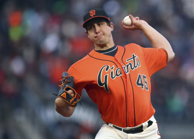San Francisco Giants pitcher Derek Holland works against the Colorado Rockies in the first inning of a baseball game Friday, May 18, 2018, in San Francisco. (AP Photo/Ben Margot)
