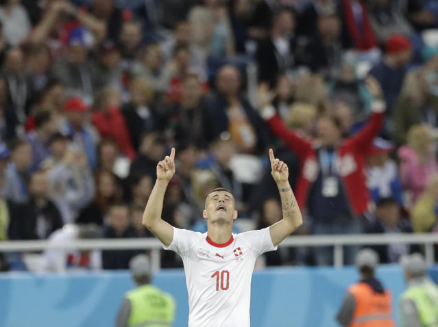 Switzerland's Granit Xhaka celebrates after scoring his side's first goal during the group E match between Switzerland and Serbia at the 2018 soccer World Cup in the Kaliningrad Stadium in Kaliningrad, Russia, Friday, June 22, 2018. (AP Photo/Matthias Schrader)
