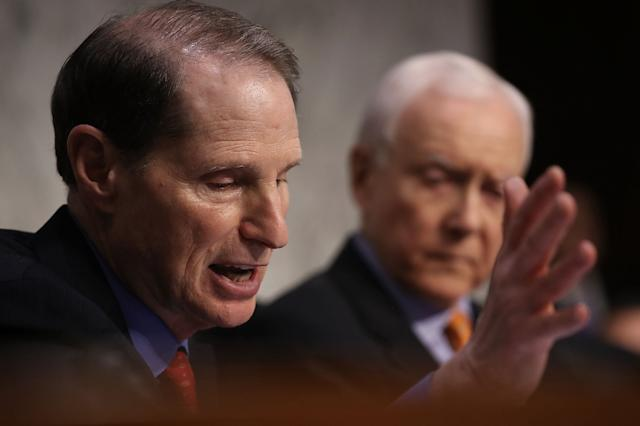 Sen. Ron Wyden (D-Ore.) speaks during a Senate Finance Committee session Tuesday on the GOP tax reform bill. Senate Republicans announced their intention to include a repeal of the Affordable Care Act's mandate for taxpayers to have health insurance in the tax bill.
