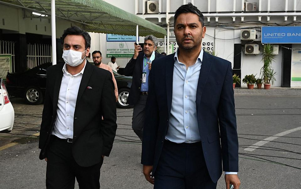Chief Executive Officer of the Pakistan Cricket Board (PCB) Wasim Khan (R) leaves after meeting with Interior Ministery officials in Islamabad on September 17, 2021, after New Zealand postponed a series of one-day international (ODI) cricket matches against Pakistan over security concerns. - GETTY IMAGES