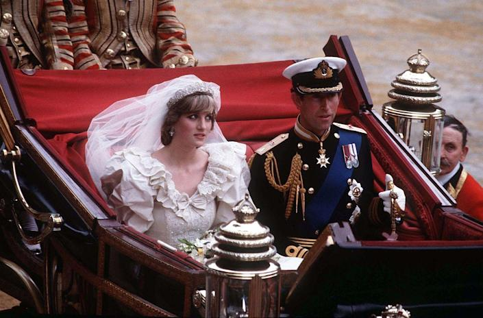 """<p>When Princess Diana walked down the aisle at her wedding to Prince Charles on July 29, 1981, she was looking for Camilla Parker Bowles. The princess revealed to <a href=""""https://www.amazon.com/Diana-Her-True-Story-Words/dp/1501169734"""" rel=""""nofollow noopener"""" target=""""_blank"""" data-ylk=""""slk:biographer Andrew Morton"""" class=""""link rapid-noclick-resp"""">biographer Andrew Morton</a> in 1991 (via <em><a href=""""https://www.goodhousekeeping.com/life/a20900063/camilla-parker-bowles-at-princess-diana-royal-wedding/"""" rel=""""nofollow noopener"""" target=""""_blank"""" data-ylk=""""slk:Good Housekeeping"""" class=""""link rapid-noclick-resp"""">Good Housekeeping</a></em>), """"I knew she was in there, of course. I looked for her. ... So walking down the aisle, I spotted Camilla, pale gray, veiled pillbox hat, saw it all, her son Tom standing on a chair. To this day you know—vivid memory.""""</p>"""