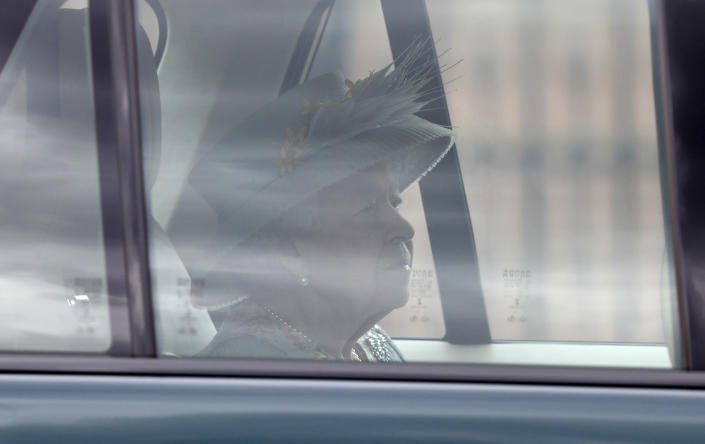 Britain's Queen Elizabeth II leaves Buckingham Palace by car to attend the State Opening of Parliament at the Palace of Westminster in London, Tuesday May 11, 2021. (AP Photo/Alastair Grant)