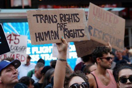 People protest President Trump's announcement that he plans to reinstate a ban on transgender individuals from serving in any capacity in the U.S. military, in Times Square, New York City, in July.    REUTERS/Carlo Allegri