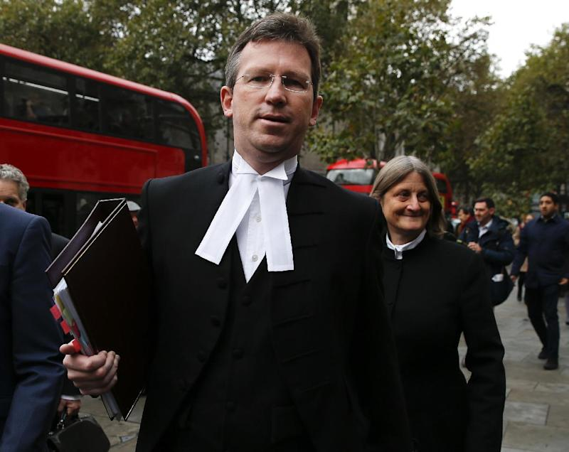 FILE - This is a Thursday, Oct. 13, 2016  file photo of Attorney General of England and Wales Jeremy Wright arrives at the High Court in London. Britain's top law officer  Jeremy Wright said Wednesday Jan. 11, 2017  it is legal to kill militants overseas if they pose an immediate and otherwise unstoppable threat. (AP Photo/Alastair Grant, File)