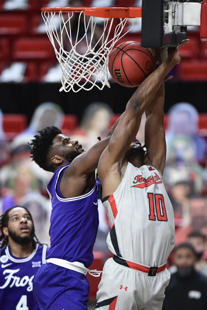 Texas Tech's Tyreek Smith (10) is fouled by TCU's Mike Miles during the first half of an NCAA college basketball game in Lubbock, Texas, Tuesday, March 2, 2021. (AP Photo/Justin Rex)