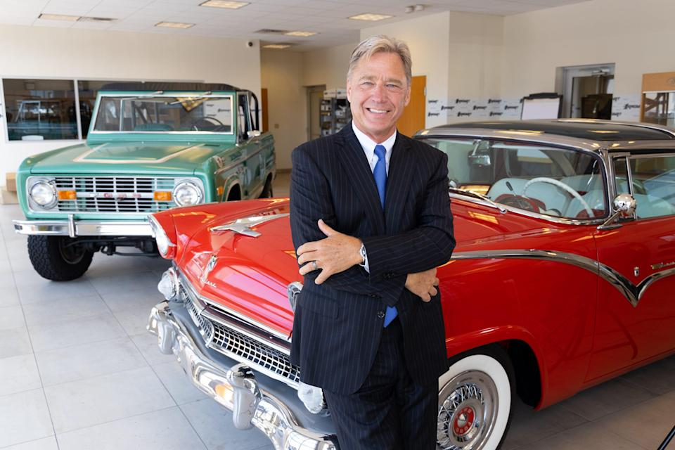 Rhett Ricart, seen here on August 14, 2019 at the Ricart Mega Mall in Columbus, Ohio is standing beside a 1977 Ford Bronco and 1955 Ford Crown Victoria. He said on July 19 that dealers are eager for inventory and happy to have techs install semiconductor chips when they arrive.