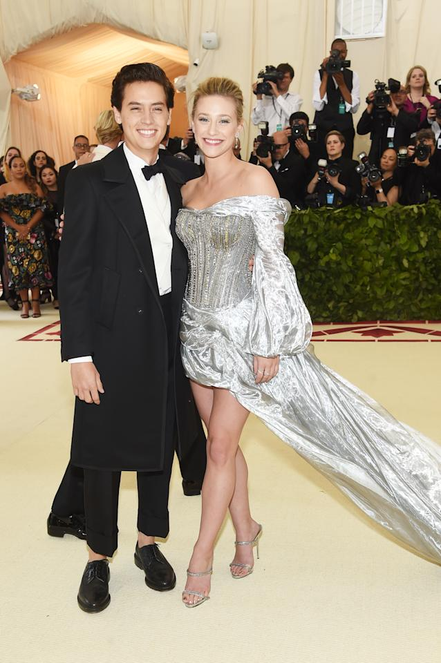 <p>The 'Riverdale' duo made their public debut at the 2018 Met Gala. Lili wore a dress from H&M for the event while Cole was dapper in a Thom Browne tux. <em>[Photo: Getty]</em> </p>