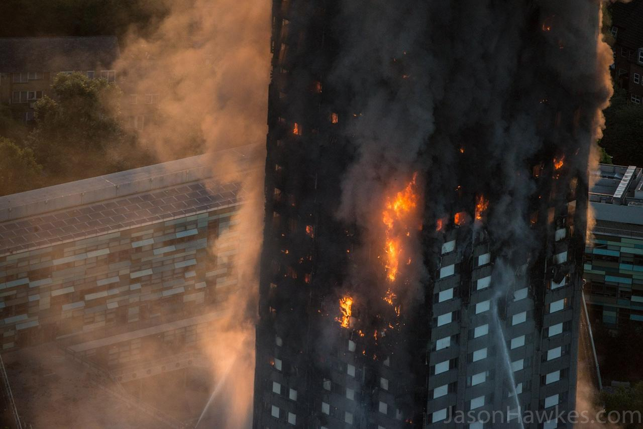 <p>Photos taken from a helicopter show the extent of the Grenfell Tower fire in London, England on June 14, 2017. (Photo from Storyful/Twitter/Jason Hawkes) </p>