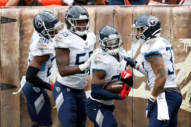 A Cleveland Browns fan appeared to spray beer on Tennessee Titans players after Malcolm Butler's fourth quarter pick-6. (Getty Images)