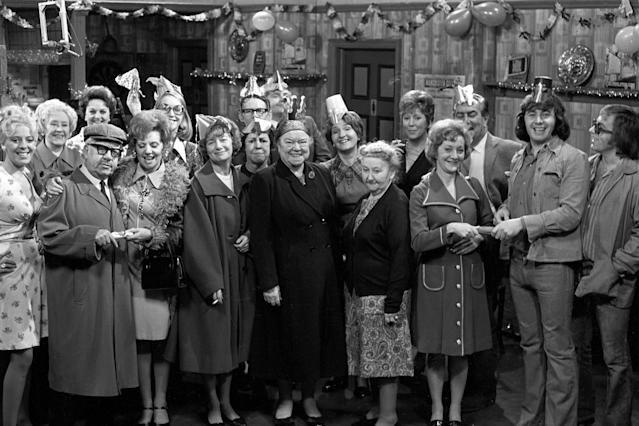 Coronation Street stars Julie Goodyear as Bet Lynch; Doris Speed as Annie Walker; Jack Howarth as Albert Tatlock; Betty Driver as Betty Turpin (behind); Barbara Knox as Rita Littlewood; Anne Kirkbride as Deidre Hunt (behind), as Jean Alexander as Hilda Ogden; unidentified; Stephen Hancock as Ernest Bishop; as Geoffrey Hughes as Eddie Yeats; Violet Carson as Ena Sharples; Eileen Derbyshire as Emily Bishop; Margo Bryant as Minnie Caldwell; unidentified; Thelma Barlow as Mavis Riley; Bernard Youens as Stan Ogden; Neville Buswell as Ray Langdon; unidentified. (Photo by PA Images via Getty Images)