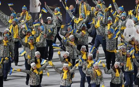 Ukraine's flag-bearer Valentina Shevchenko leads her country's contingent during the opening ceremony of the 2014 Sochi Winter Olympics, February 7, 2014. REUTERS/Grigory Dukor