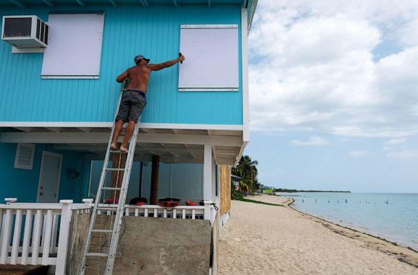PHOTO: A man boards up a window of a beach house in the tourist zone of El Combate as Tropical Storm Dorian approaches in Cabo Rojo, Puerto Rico, Aug. 27, 2019. (Ricardo Arduengo/Reuters)