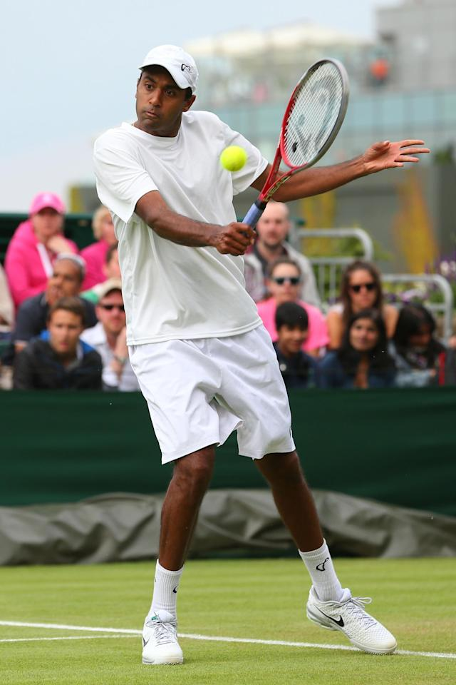 LONDON, ENGLAND - JUNE 26: Rajeev Ram of the United States of America plays a backhand during his Gentlemen's Singles second round match against Juan Monaco of Argentina on day three of the Wimbledon Lawn Tennis Championships at the All England Lawn Tennis and Croquet Club on June 26, 2013 in London, England. (Photo by Julian Finney/Getty Images)