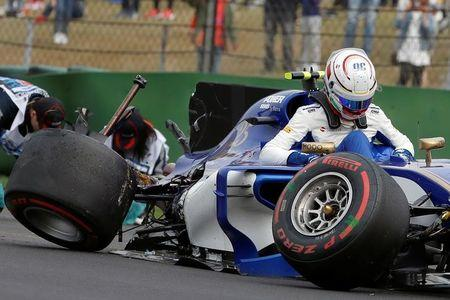 Formula One - F1 - Chinese Grand Prix - Shanghai, China - 08/04/17 - Sauber driver Antonio Giovinazzi of Italy steps out of his car after crashing during the qualifying session at the Shanghai International Circuit. REUTERS/Aly Song