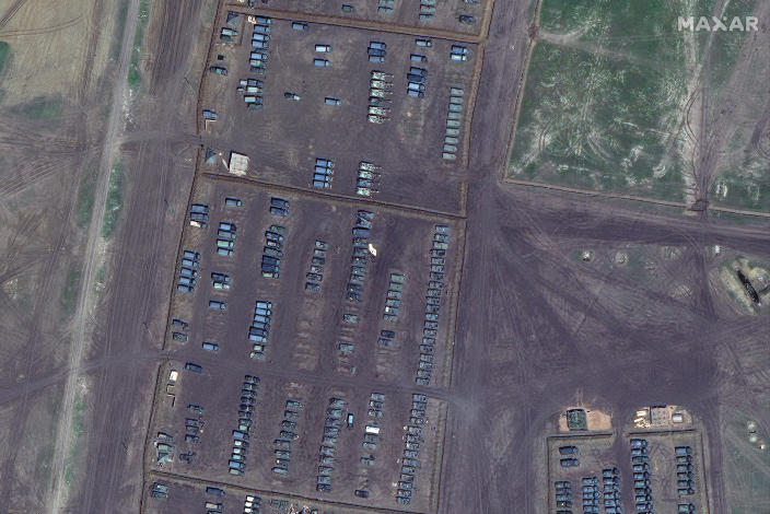 This image provided by Maxar Technologies shows overview of tanks, self propelled artillery and armored vehicles at Opuk training area at the Black Sea coast of Crimea on Thursday, April 15, 2021. Russia has insisted that it has the right to restrict foreign naval ships' movement off Crimea, rejecting Ukrainian complaints and Western criticism. Ukraine last week protested the Russian move to close broad areas of the Black Sea near Crimea to foreign navy ships and state vessels until November. (Satellite image ©2021 Maxar Technologies via AP)