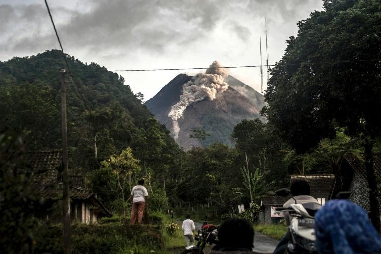 Indonesia's Mount Merapi has erupted, belching out hot ash clouds which travelled as far as three kilometres away from its crater