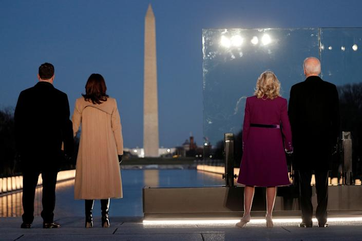 President-elect Joe Biden, his wife Jill Biden, Vice President-elect Kamala Harris and her husband Doug Emhoff stand in front of the Washington Monument during a COVID-19 victims memorial in Washington, on January 19, 2021. (Tom Brenner/Reuters)