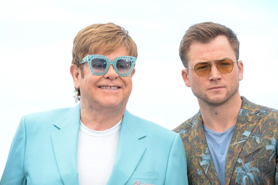 """CANNES, FRANCE - MAY 17: Elton John and Taron Egerton attend the """"Rocketman"""" Photocall during the 72nd annual Cannes Film Festival on May 17, 2019 in Cannes, France. (Photo by Stephane Cardinale - Corbis/Corbis via Getty Images)"""