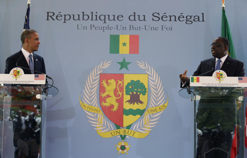 U.S. President Barack Obama, left, and Senegalese counterpart Macky Sall speak during a joint press conference at the presidential palace in Dakar, Senegal, Thursday, June 27, 2013. President Obama was in Senegal Thursday as part of a weeklong trip to Africa, a three-country visit aimed at overcoming disappointment on the continent over the first black U.S. president's lack of personal engagement during his first term. (AP Photo/Rebecca Blackwell)
