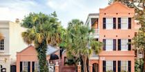 """<p>Housed in an 1881 coral-colored building, <a href=""""https://go.redirectingat.com?id=74968X1596630&url=https%3A%2F%2Fwww.tripadvisor.com%2FHotel_Review-g54171-d111459-Reviews-The_Elliott_House_Inn-Charleston_South_Carolina.html&sref=https%3A%2F%2Fwww.redbookmag.com%2Fabout%2Fg34149750%2Fmost-historic-hotels%2F"""" rel=""""nofollow noopener"""" target=""""_blank"""" data-ylk=""""slk:The Elliott House Inn"""" class=""""link rapid-noclick-resp"""">The Elliott House Inn</a> is one of <a href=""""https://www.bestproducts.com/fun-things-to-do/g3002/trendy-things-to-do-in-charleston-sc/"""" rel=""""nofollow noopener"""" target=""""_blank"""" data-ylk=""""slk:Charleston's"""" class=""""link rapid-noclick-resp"""">Charleston's</a> most historic hotels. Design details include original hardwood floors and custom plantation shutters, and there's a shaded courtyard. Just steps away is <a href=""""https://www.tripadvisor.com/Restaurant_Review-g54171-d1943833-Reviews-Husk_Restaurant-Charleston_South_Carolina.html"""" rel=""""nofollow noopener"""" target=""""_blank"""" data-ylk=""""slk:Husk"""" class=""""link rapid-noclick-resp"""">Husk</a>, considered to be the city's best restaurant. </p>"""