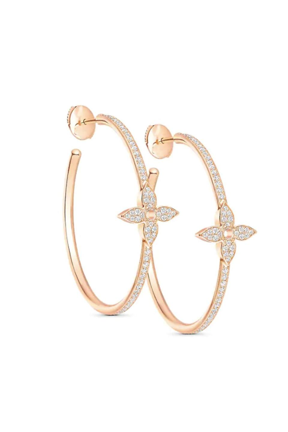 """<p><strong>Louis Vuitton</strong></p><p><strong>$9450.00</strong></p><p><a href=""""https://us.louisvuitton.com/eng-us/products/idylle-blossom-hoops-pink-gold-and-diamonds-nvprod2070007v"""" rel=""""nofollow noopener"""" target=""""_blank"""" data-ylk=""""slk:Shop Now"""" class=""""link rapid-noclick-resp"""">Shop Now</a></p><p>You can wear this refined version of the iconic Louis Vuitton monogram with virtually any look. </p>"""