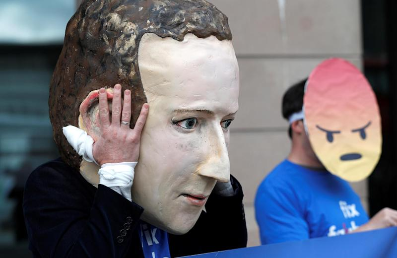 Protesters from the pressure group Avaaz demonstrate against Facebook outside Portcullis House in Westminster: Reuters