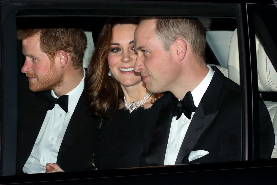 Kate Middleton with Prince William and Prince Harry in a car