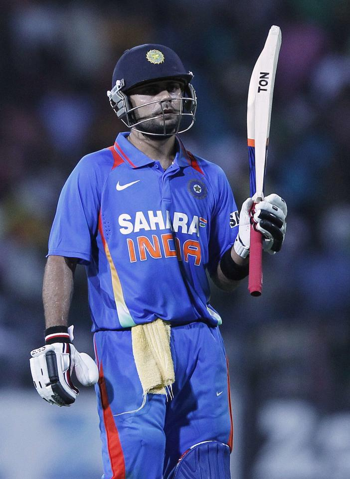 India's Virat Kohli walks off the field after his dismissal during the third One-Day International cricket match against Sri Lanka in Colombo, July 28, 2012.    REUTERS/Dinuka Liyanawatte (SRI LANKA - Tags: SPORT CRICKET)
