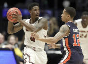 South Carolina guard Tre Campbell (4) looks to pass around Auburn guard J'Von McCormick (12) in the first half of an NCAA college basketball game at the Southeastern Conference tournament Friday, March 15, 2019, in Nashville, Tenn. (AP Photo/Mark Humphrey)