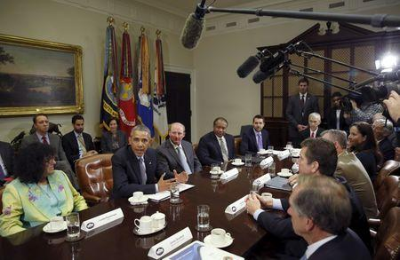 U.S. President Barack Obama hosts a roundtable with CEOs to discuss efforts to tackle climate change both in the United States as well as on a global scale at the White House in Washington, DC, U.S. on October 19, 2015. REUTERS/Kevin Lamarque/File Photo