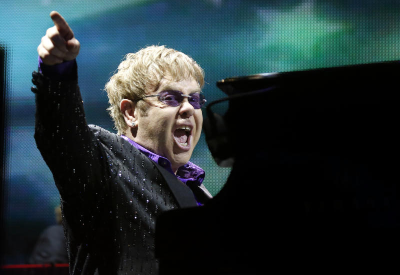 FILE - This June 30, 2012 file photo shows British pop star Elton John performing during the Euro 2012 soccer championship in Kiev, Ukraine. Elton John has canceled a show in London's Hyde Park after being diagnosed with appendicitis that will require surgery. A statement issued Tuesday July 9, 2013 by the musician's publicist said John was suffering from an inflamed appendix and surrounding abscess. The 66-year-old performer had been due to play an outdoor concert in London's Hyde Park on Friday on a bill with Elvis Costello and Ray Davies.(AP Photo/Efrem Lukatsky, file)