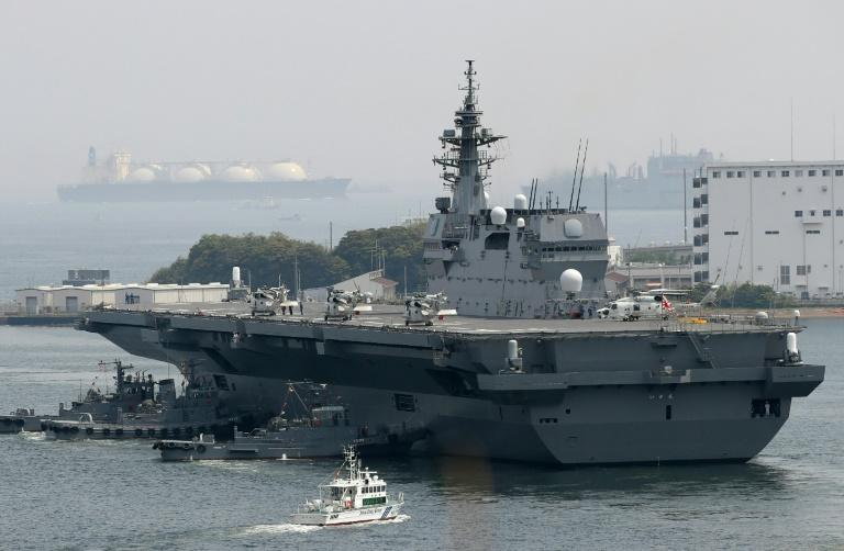 Japan on May 1 dispatched its biggest warship since World War II to protect a US supply ship, one of the country's military roles expanded under Prime Minister Shinzo Abe, as tensions mount in the region over North Korea