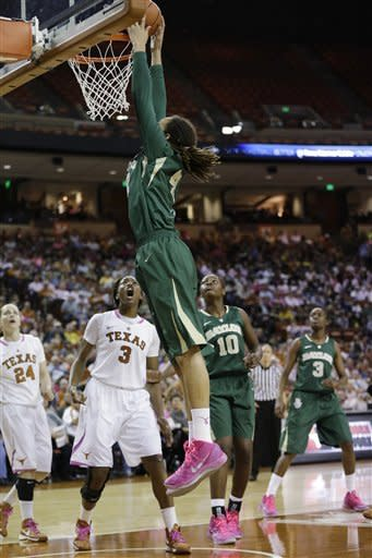 Baylor's Brittney Griner dunks over Texas' Nneka Enemkpali (3) during the second half of an NCAA college basketball game, Saturday, Feb. 9, 2013, in Austin, Texas. Baylor won 75-48. (AP Photo/Eric Gay)