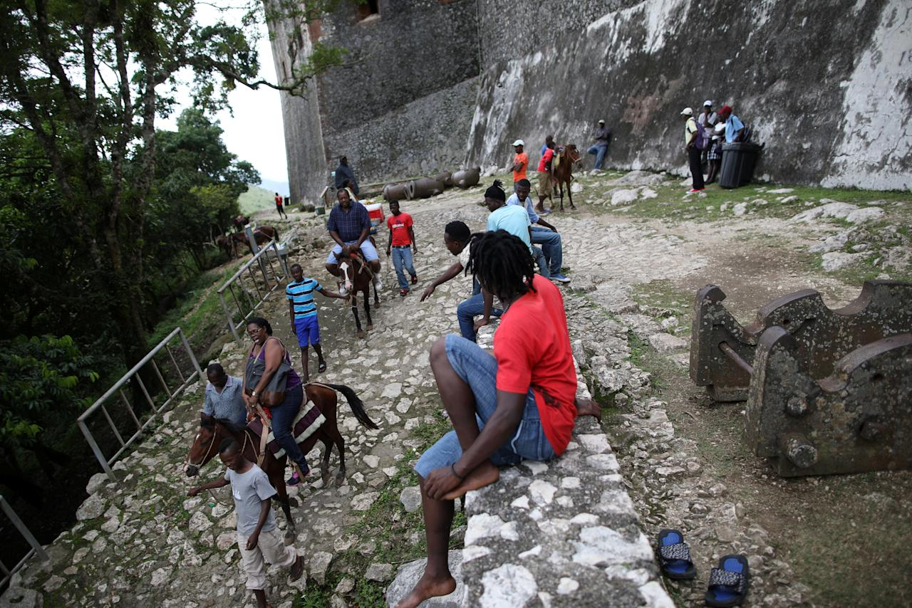 American tourists Janet Moore and Leonard Moore ride horses on their way down from the Citadel Laferriere in Milot, Haiti, November 19, 2017. The Citadel Laferriere is one of the main touristic attractions in Haiti and it is considered a World Heritage Site according to United Nations Educational, Scientific and Cultural Organization (UNESCO). REUTERS/Andres Martinez Casares