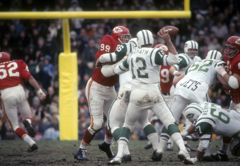 KANSAS CITY, MO - NOVEMBER 5:  Ernie Ladd #99 of the Kansas City Chiefs rushes quarterback Joe Namath #12 of the New York Jets during an NFL football game at Kansas City Municipal Stadium November 5, 1967 in Kansas City, Missouri. Ladd played for the Chiefs from 1967-68. (Photo by Focus on Sport/Getty Images)