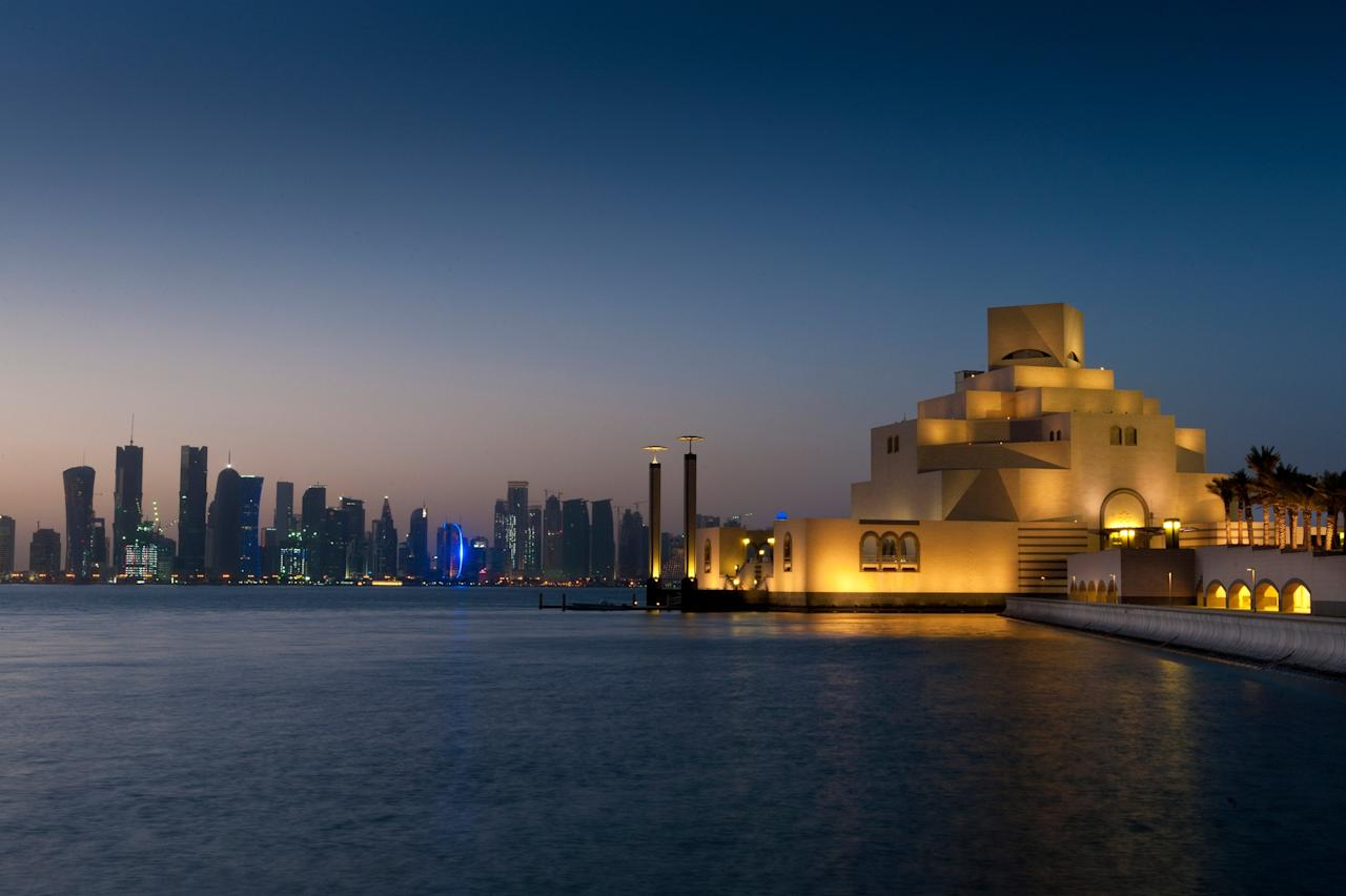 """Qatar's location on a peninsula jutting into the Persian Gulf is certainly one reason to fly long haul for some winter sun. Even better, temperatures regularly hit the mid 80s each afternoon, with low humidity and unbroken sunshine. (For sheer indulgence, book a pair of seats on Qatar Airways, whose <a href=""""https://www.cntraveler.com/story/qatar-airways-business-class-qsuites-offer-double-beds?mbid=synd_yahoo_rss"""">premium QSuites</a> convert into customizable double beds.) Make the most of the country's seafront setting on The Pearl, a manmade island located off the capital <a href=""""https://www.cntraveler.com/story/why-doha-is-much-more-than-a-stopover-destination?mbid=synd_yahoo_rss"""">Doha</a>, which has its own lagoon. The country has also splurged on splashy cultural institutions in the last decade, aiming to turn itself into the gulf's arty hub: There's the waterfront Katara cultural complex, with its theaters and concert halls, as well as the Jean Nouvel-designed <a href=""""http://www.qm.org.qa/en/project/national-museum-qatar"""">National Museum of Qatar</a>, which celebrates its one year anniversary this month. Plus, Doha is also home to one of the last works by the late I.M. Pei: the Museum of Islamic Art along the harbor. But don't let the gleaming splendor distract you from the Souq Waqif, a centuries-old, labyrinthine market filled with stalls and cafes; the Persian food at Parisa is a standout."""