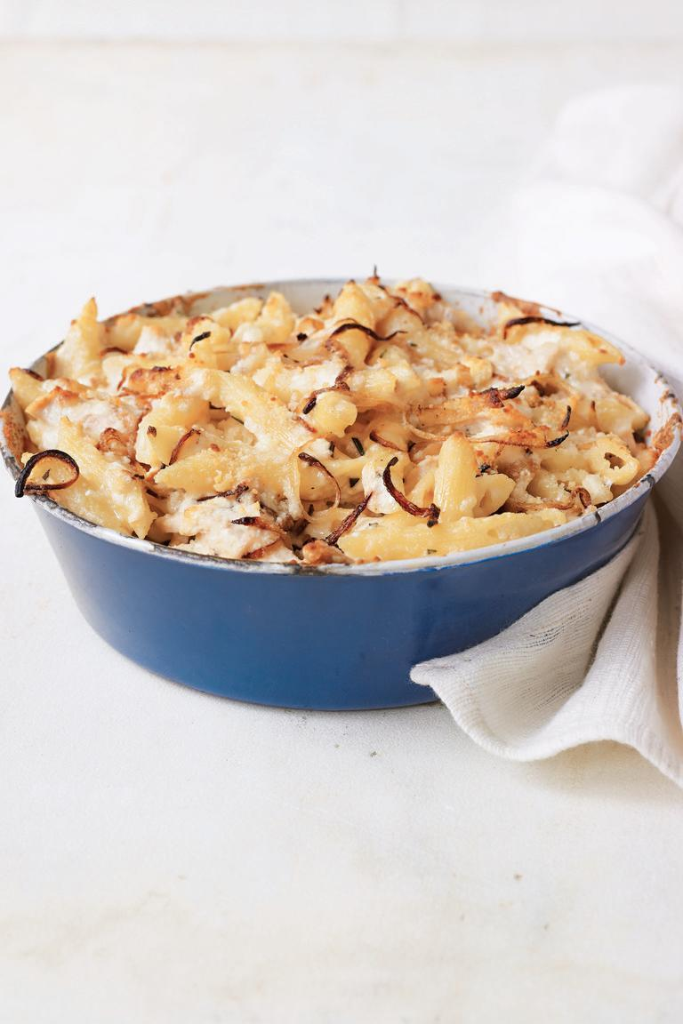 """<p>Instead of the usual Cheddar, this satisfying casserole calls for smoked mozzarella and Parmigiano-Reggiano, as well as a creamy rosemary béchamel. Add already-made roast chicken to the macaroni.</p><p><strong><a href=""""https://www.countryliving.com/food-drinks/recipes/a3464/macaroni-cheese-chicken-recipe-clv1010/"""" rel=""""nofollow noopener"""" target=""""_blank"""" data-ylk=""""slk:Get the recipe."""" class=""""link rapid-noclick-resp"""">Get the recipe.</a></strong></p>"""