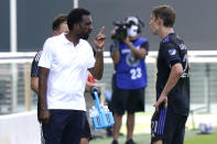 CF Montreal head coach Wilfried Nancy, left, talks with midfielder Lassi Lappalainen during the second half of an MLS soccer match against Columbus Crew, Saturday, May 1, 2021, in Fort Lauderdale, Fla. The game ended in a 0-0 tie. (AP Photo/Lynne Sladky)