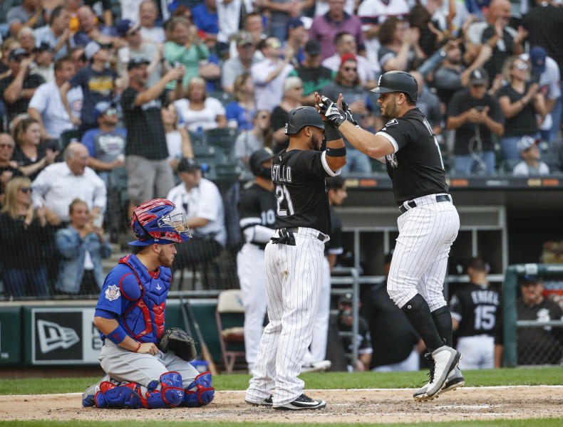 Chicago White Sox's Daniel Palka, right, celebrates with Welington Castillo, center, after hitting a two-run home run against the Chicago Cubs during the sixth inning of a baseball game Friday, Sept. 21, 2018, in Chicago. (AP Photo/Kamil Krzaczynski)