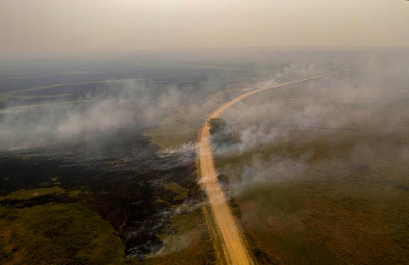 TOPSHOT - Aerial view showing a fire at the Transpantaneira park road in the Pantanal wetlands, Mato Grosso state, Brazil, on September 14, 2020. - The Pantanal, a region famous for its wildlife, is suffering its worst fires in more than 47 years, destroying vast areas of vegetation and causing death of animals caught in the fire or smoke. (Photo by MAURO PIMENTEL / AFP) (Photo by MAURO PIMENTEL/AFP via Getty Images)